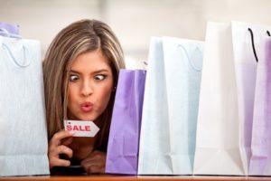 Compulsive shopping woman enjoying the sale season